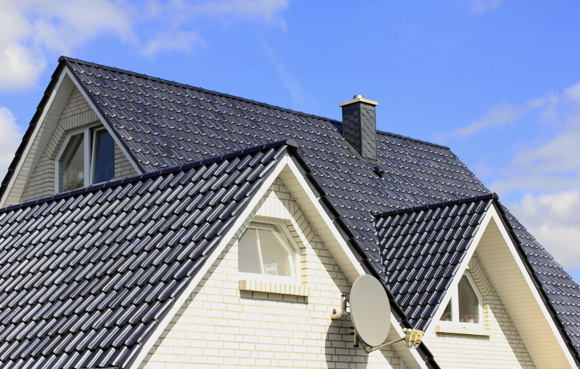 Residential Roof With Dark Slate Shingles